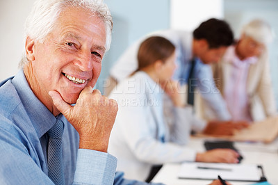 Buy stock photo Closeup portrait of sucessful senior business man smiling with colleagues at the back