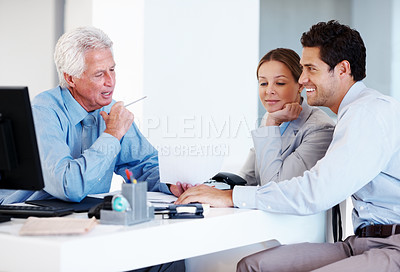 Buy stock photo Financial planner helping a couple with their banking accounts while signing on documents