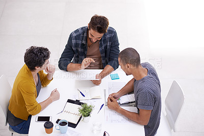 Buy stock photo Shot of a team of diverse colleagues having a meeting in a modern office