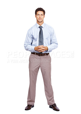 Buy stock photo Portrait of a confident young businessman standing isolated on white background