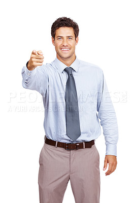 Buy stock photo Portrait of a smiling young male business executive pointing at you against white background