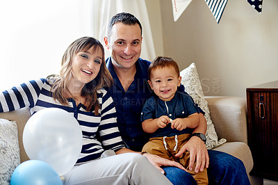 Buy stock photo Shot of a happy family celebrating their son's first birthday at home