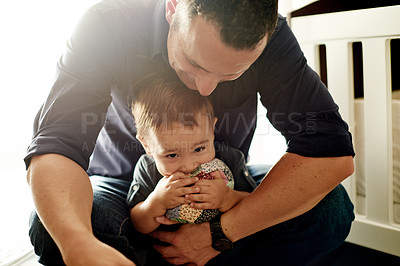 Buy stock photo Shot of a father and his little son at home