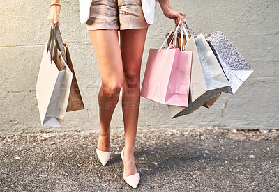 Buy stock photo Cropped shot of a young woman out shopping in the city