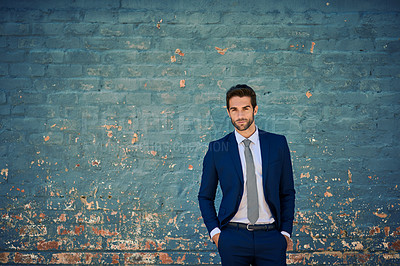 Buy stock photo Portrait of a young corporate businessman standing against a brick wall
