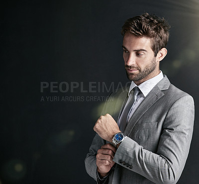 Buy stock photo Studio shot of a confident young businessman against a black background