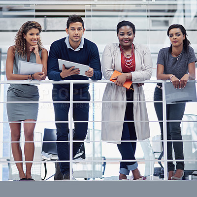Buy stock photo Portrait of a group of colleagues working together in an office