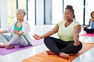Buy stock photo Shot of a group of women meditating indoors