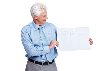 Buy stock photo Portrait of a happy old male business executive looking at blank billboard in his hand over white background