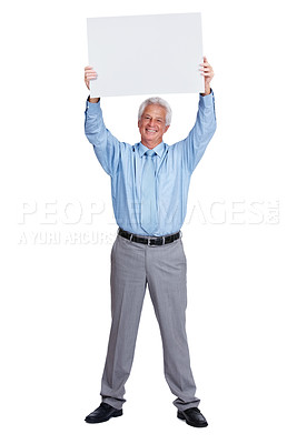 Buy stock photo Portrait of a happy mature business man holding up a blank billboard over head isolated against white background