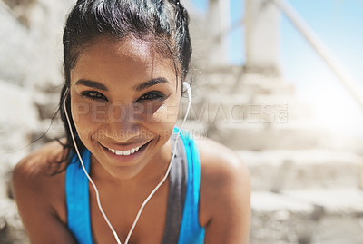 Buy stock photo Portrait of a young sporty woman with earphones on