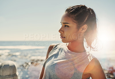 Buy stock photo Shot of a young sporty woman standing outside