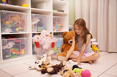 Buy stock photo Shot of a young girl playing with toys in a room