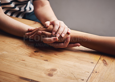 Buy stock photo Shot of two people holding hands in comfort