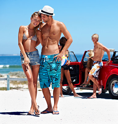 Buy stock photo Portrait of a young couple in swimwear enjoying a road trip to the beach