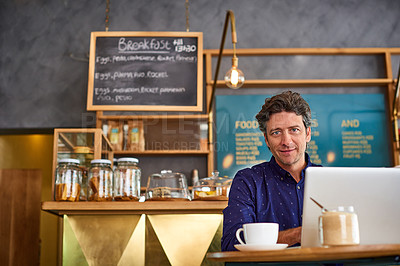 Buy stock photo Portrait of a man sitting in a cafe bakery working on a laptop