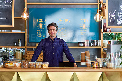 Buy stock photo Portrait of man standing behind the counter in a cafe