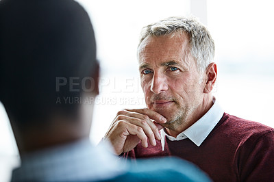 Buy stock photo Shot of two colleagues talking together in an office