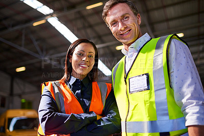 Buy stock photo Portrait of two workers standing in a large warehouse