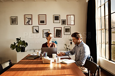 Buy stock photo Shot of a couple working at their dining table