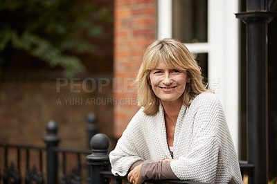 Buy stock photo Portrait of a mature woman leaning against the railing of her front porch