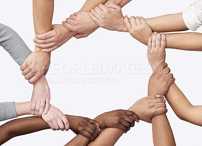 Buy stock photo Cropped shot of a diverse group of hands joined together