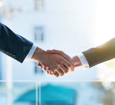 Buy stock photo Shot of two businesspeople shaking hands
