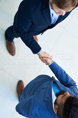 Buy stock photo Shot of two businessmen shaking hands