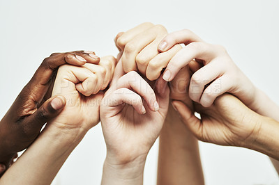 Buy stock photo Shot of a group of hands holding onto each other against a white background