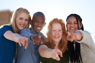 Buy stock photo Portrait of a group of people pointing their fingers forward