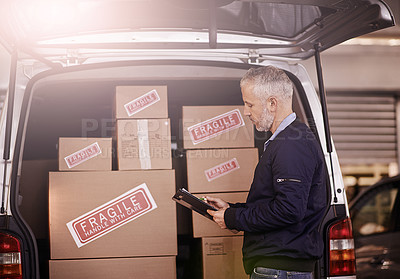 Buy stock photo Shot of a mature delivery man standing next to a van packed with boxes
