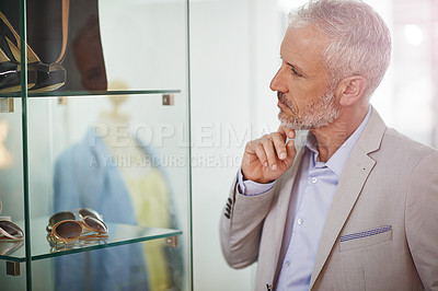 Buy stock photo Shot of a mature man window shopping in a mall