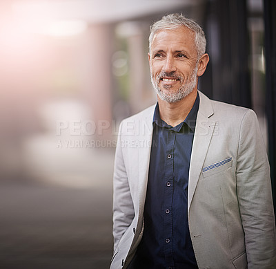 Buy stock photo Shot of a mature businessman standing outside