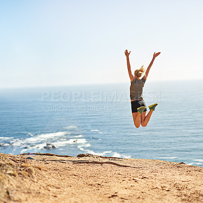 Buy stock photo Shot of a young woman jumping for joy after her workout