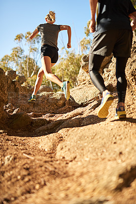 Buy stock photo Shot of a young couple out for a trail run