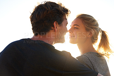 Buy stock photo Shot of a loving couple looking into each other's eyes