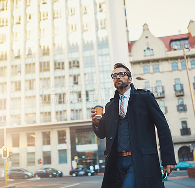 Buy stock photo Shot of a young businessman on the move in the city