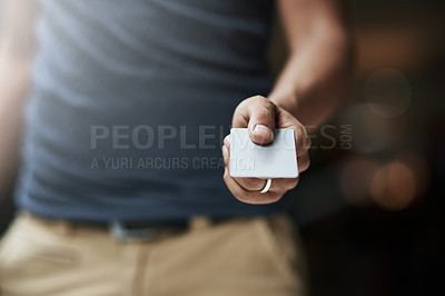 Buy stock photo Shot of a man holding out a credit card