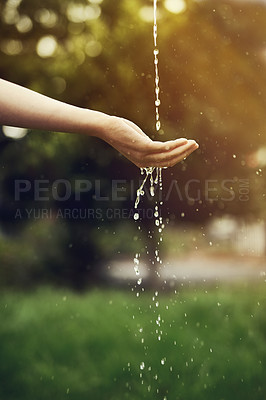 Buy stock photo Cropped shot of water running on a woman's hand outside