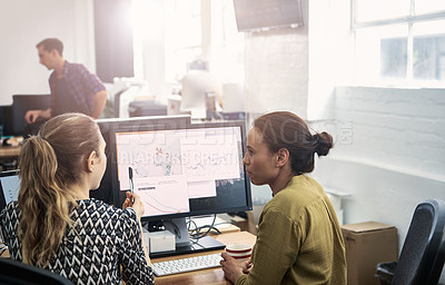 Buy stock photo Shot of coworkers using a computer together in a modern office