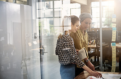 Buy stock photo Shot of coworkers working on a project together in a modern office