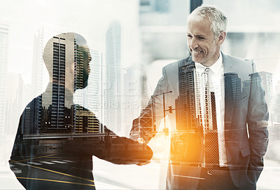 Buy stock photo Multiple exposure shot of two businesspeople shaking hands superimposed on a cityscape