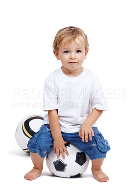 Buy stock photo Portrait of a happy adorable small boy sitting on the football isolated over white background
