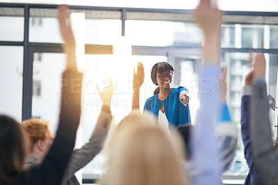 Buy stock photo Cropped shot of a group of people raising their hands in a class