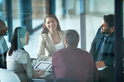 Buy stock photo Cropped shot of a group of businesspeople sitting in a meeting