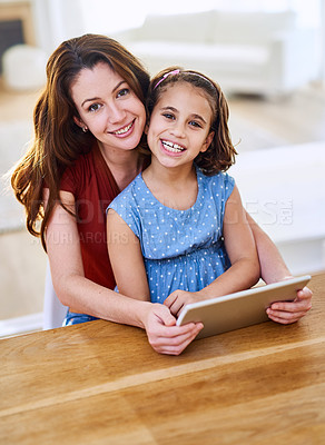 Buy stock photo Portrait of a mother and daughter using a digital tablet together at home