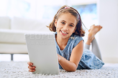 Buy stock photo Portrait of a young girl using a digital tablet at home