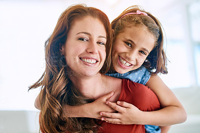 Buy stock photo Portrait of a mother giving her daughter a piggyback ride at home