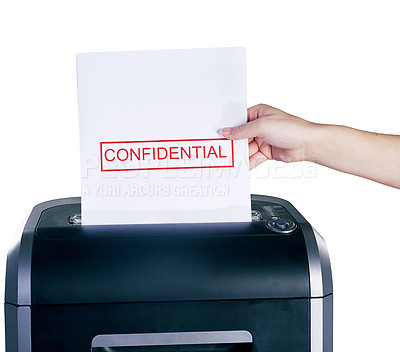 Buy stock photo Studio shot of a woman's hand placing a confidential document into a shredder against a white background