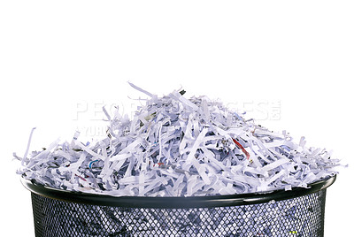 Buy stock photo Studio shot of shredded paper in a dustbin against a white background